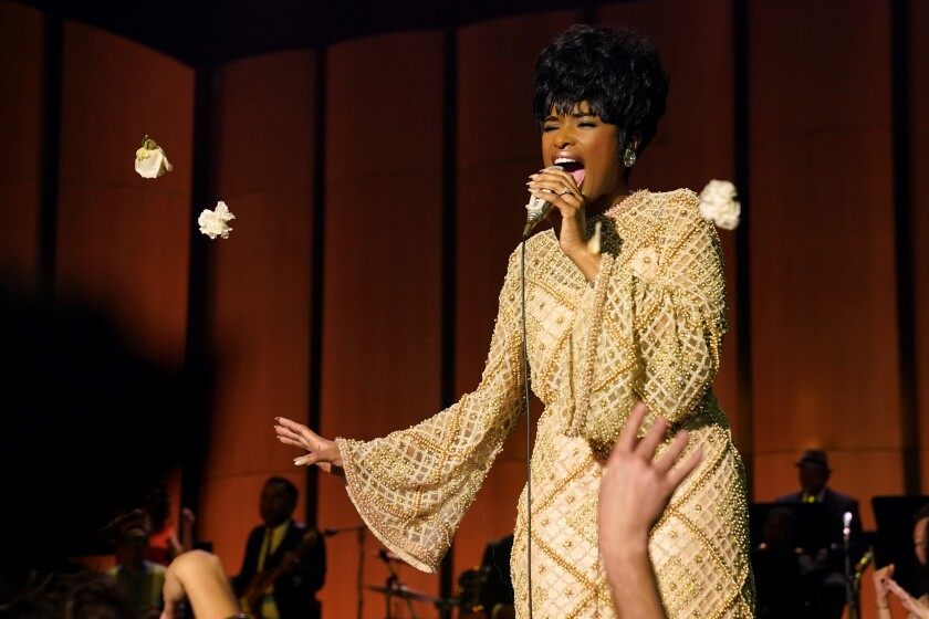 """Jennifer Hudson as Aretha Franklin sings into a microphone in the movie """"Respect."""""""