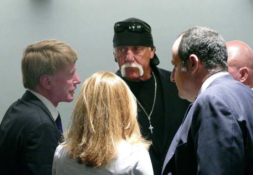 Hulk Hogan, center, whose real name is Terry Bollea, huddles with his legal team as he appears in court, Wednesday, May 25, 2016, in St. Petersburg, Fla. A Florida judge on Wednesday denied Gawker's motion for a new trial in Hogan's sex-video case and won't reduce a $140 million jury verdict. (Scot