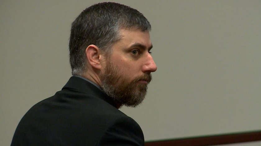 Former police officer Stephen Rankin in court in Portsmouth, Va.
