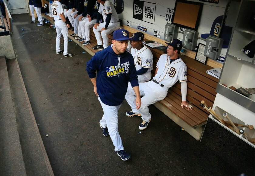 Padres manager Andy Green walks the dugout before the game against the San Francisco Giants.