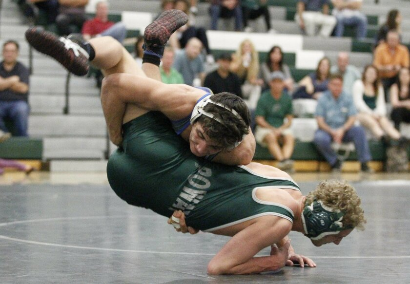 Rancho Bernardo's Chaz Franchina throws Poway's Sam Brown in the dual team championships.