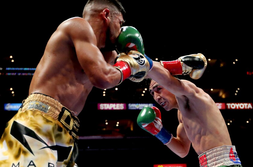 Leo Santa Cruz, right, lands a left jab against Abner Mares in a previous featherweight bout.