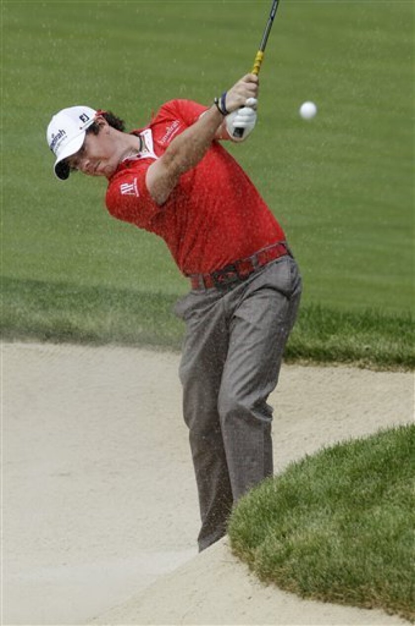 Rory McIlroy, from Northern Ireland, hits from a fairway bunker on the 18th hole during the second round of the Memorial golf tournament at Muirfield Village Golf Club in Dublin, Ohio, Friday, June 3, 2011. (AP Photo/Mark Duncan)