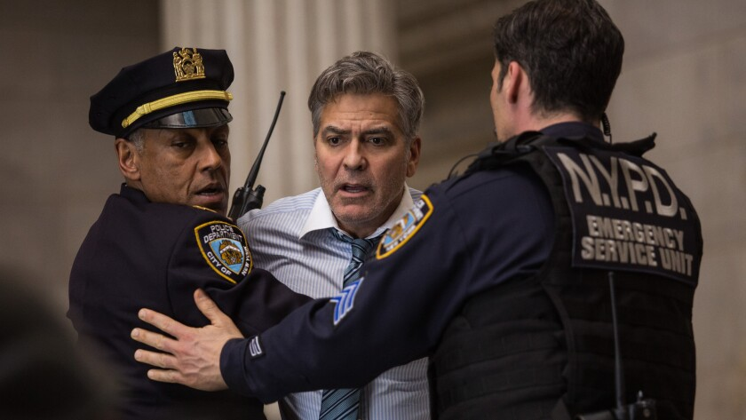 """George Clooney, center, stars with Giancarlo Esposito, left, in TriStar Pictures' """"Money Monster."""""""
