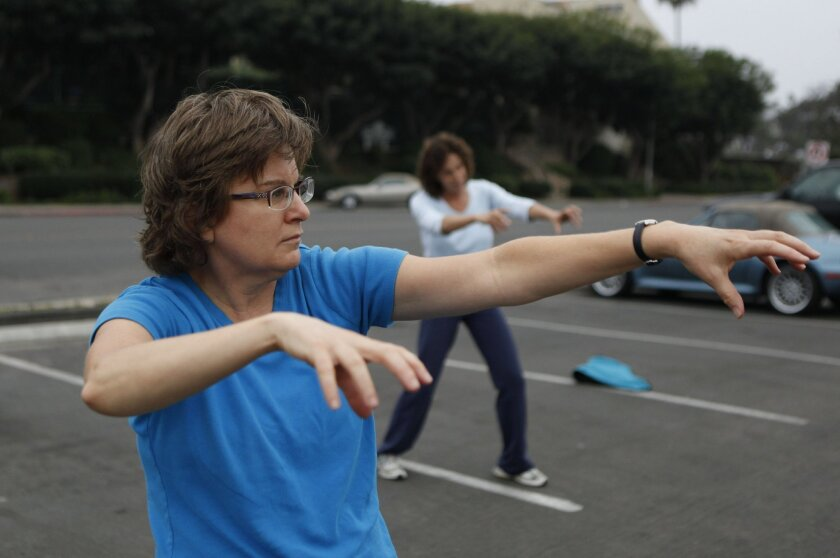 """U-T columnist Karla Peterson lets the claws come out during one of Christopher Estrella's free """"Thriller"""" dance classes. The classes will be held all month in preparation for a series of group zombie dances, including a performance before the Down Syndrome """"Buddy Walk"""" on Oct. 15th at Balboa Park."""
