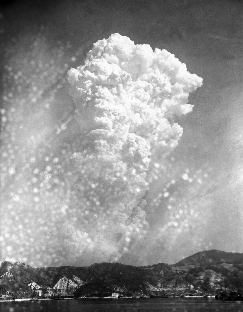 Smoke rises from the bombing of Hiroshima