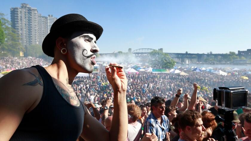 A man smokes during 4/20 marijuana rally