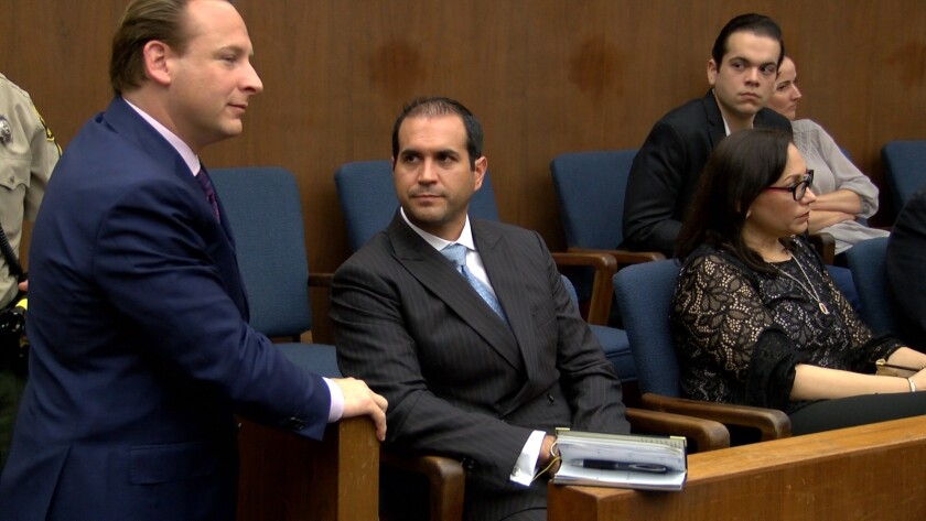 Tijuana councilman Luis Torres, seated at center, in San Diego Superior Court on Thursday with his attorney, Anthony Colombo, Jr.