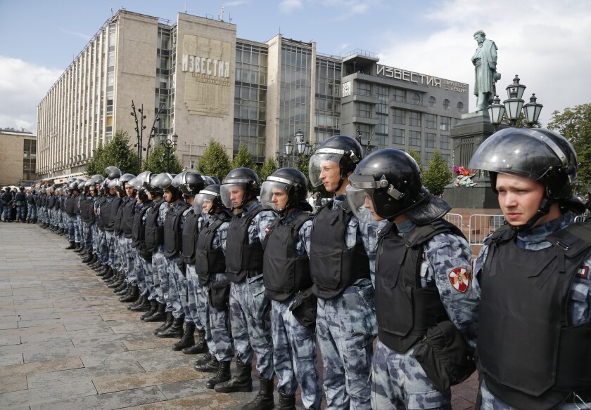 Police block a square during an unsanctioned rally in the center of Moscow on Saturday. Moscow police detained hundreds of people protesting the exclusion of some independent and opposition candidates from the city council ballot, a monitoring group said, a week after arresting nearly 1,400 at a similar protest.