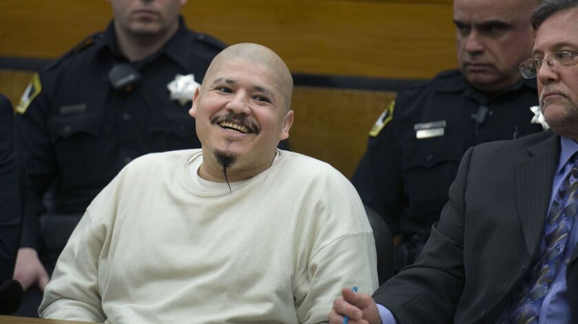 Luis Bracamontes smiles as the verdict is read that he will receive the death penalty in the murders of Sacramento County Deputy Danny Oliver and Placer County Det. Michael Davis Jr.