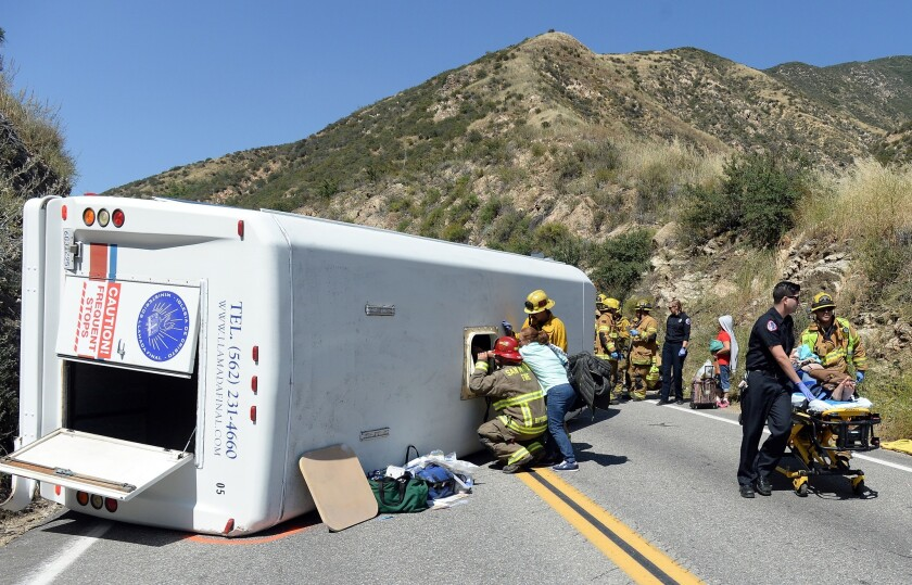 A small tour bus crashed and rolled over Sunday on Highway 330 approximately 2 miles north of the 210 Freeway, authorities said.
