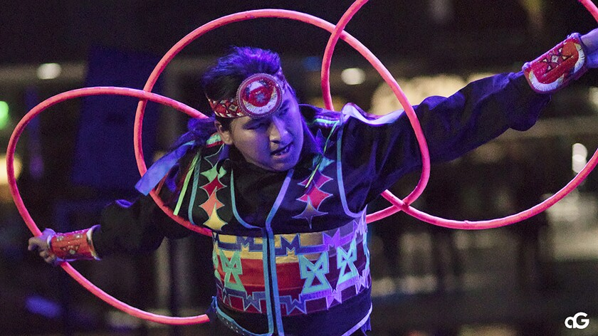 "In this Aug. 10, 2018, photo provided by Anderson Gould Jr. hoop dancer Nakotah LaRance performs at the ""Hip Hop/Electronic: Indigenous Music & Dance of the Grand Performances"" in Los Angeles. LaRance, a champion hoop dancer who traveled the world performing with Cirque du Soleil, died Sunday, July 12, 2020, after he fell while climbing on an old bridge in Rio Arriba County in New Mexico. He was 30. (Anderson Gould Jr. via AP)"
