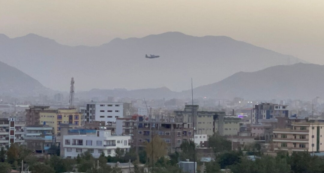 An aerial view of smoke-filled air over a neighborhood near Hamid Karzai International Airport