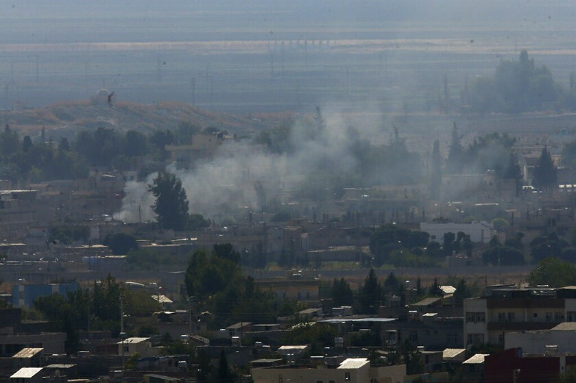 Smoke billows from targets in Ras al-Ayn, Syria, after shelling by Turkish forces Friday.