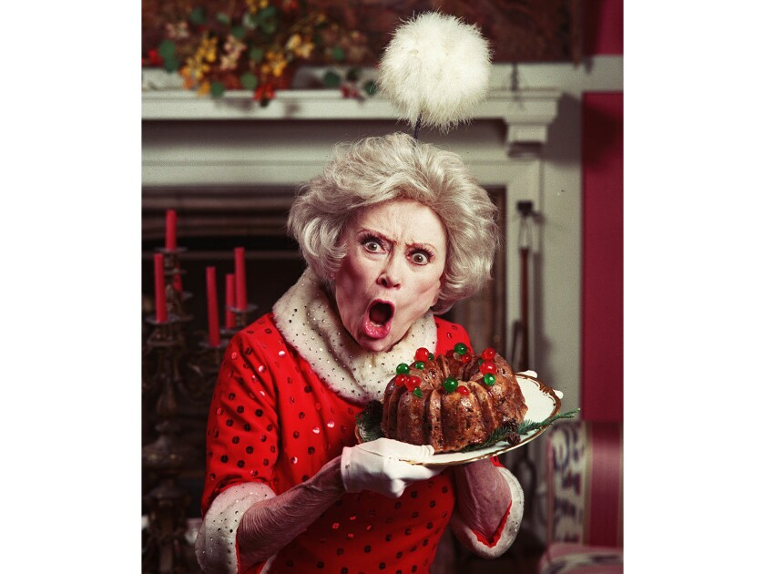 Nov. 8, 1995: Portrait of Phyllis Diller with fruitcake.
