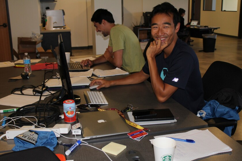 GymFlow business development manager Aria Mahboubi, left, and chief executive Jimmy Liu at work in the Viterbi Startup Garage in Marina del Rey. GymFlow is a smartphone app that displays real-time capacity of gyms.