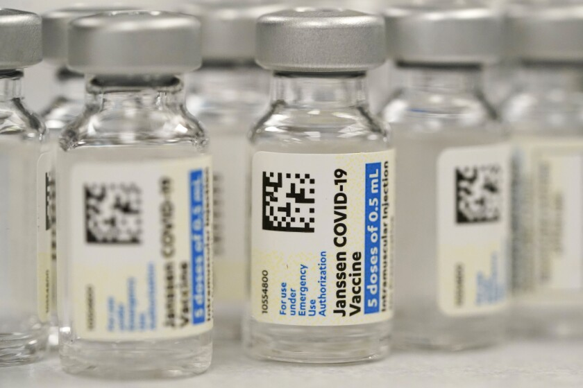 FILE - This Saturday, March 6, 2021 file photo shows vials of Johnson & Johnson COVID-19 vaccine at a pharmacy in Denver. Hundreds of thousands of COVID-19 vaccine doses have been saved from the trash after U.S. regulators extended their expiration date for a second time, part of a nationwide effort to salvage expiring shots to battle the nation's summer surge in infections. The Food and Drug Administration on Wednesday, July 28, 2021 sent a letter to shot maker Johnson & Johnson declaring that the doses remain safe and effective for at least six months when properly stored.(AP Photo/David Zalubowski, File)