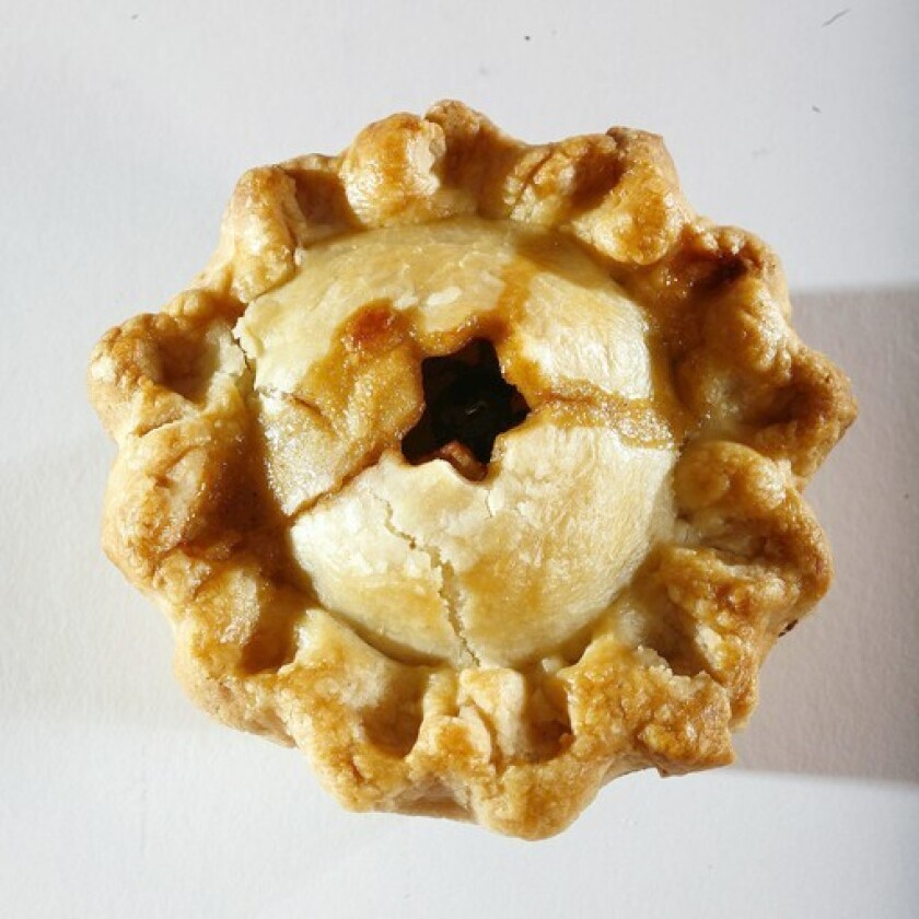 The apple mini-pie has a double crust and is loaded with rum-plumped raisins.