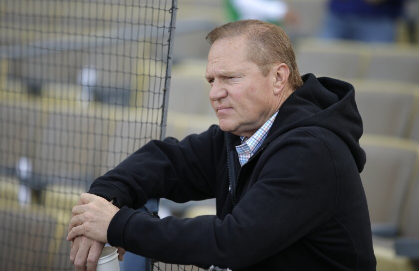 Sports agent Scott Boras watches the Miami Marlins players practice before a game against the Dodgers.