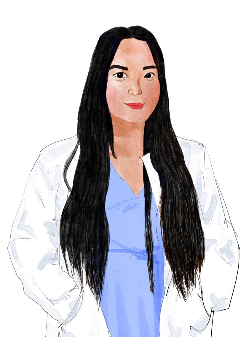 Dr. Mindy Hoang in a white coat