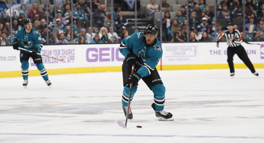 San Jose Sharks left wing Evander Kane (9) looks to pass the puck against the Vancouver Canucks during the first period of an NHL hockey game Saturday, Nov. 2, 2019, in San Jose, Calif. (AP Photo/Jim Gensheimer)