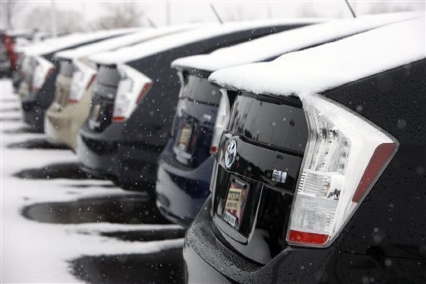 In this Feb. 7, 2010 photo, the tailends of unsold 2010 Toyota Prius sedans form a long line at a Toyota dealership in Lakewood, Colo. Toyota owners and stockholders have peppered the Japanese automaker with more than 80 class-action lawsuits in the wake of widespread recalls, some contending that