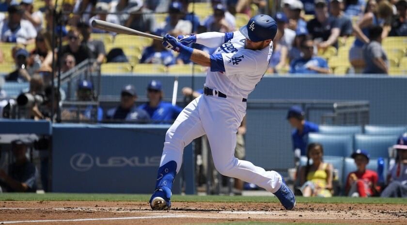 Max Muncy hits a solo home run during the second inning of Sunday's win over the San Diego Padres.