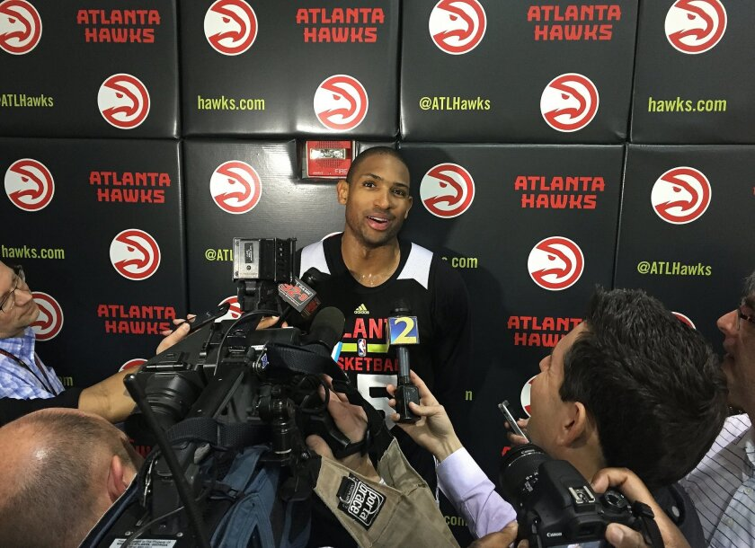 Atlanta Hawks All-Star center Al Horford speaks with the media Wednesday, Feb. 17, 2016 after practicing at Philips Arena, in Atlanta. Horford's name has been mentioned in possible trade talks with the deadline approaching Thursday. (AP Photo/Paul Newberry)