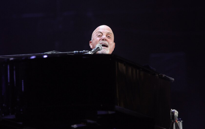 SAN DIEGO_Native New Yorker Billy Joel performed to a packed Petco Park Saturday night.|Billy Joel first came to prominence in the 1970s with tales of his time playing piano in Los Angeles area bars.|John Gastaldo/San Diego Union-Tribune