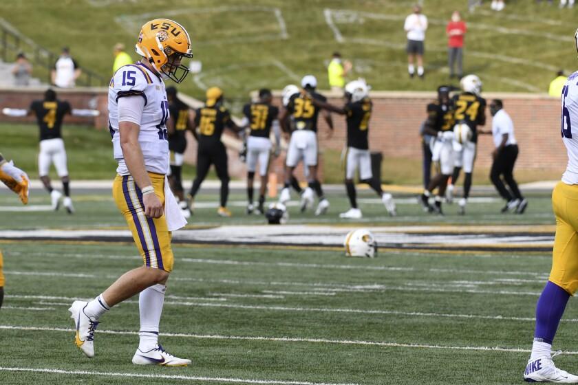 LSU quarterback Myles Brennan heads off the field as Missouri celebrates an LSU turnover.