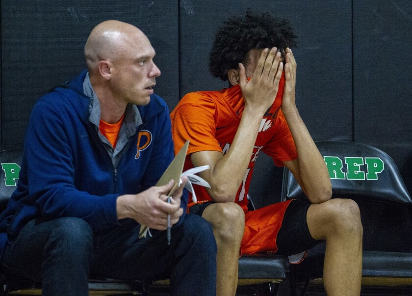 Pacifica Christian Orange County High's Houston Mallette hides his face in the final seconds of a CIF State Southern California Regional Division III quarterfinal playoff game at Fairmont Prep on Thursday.