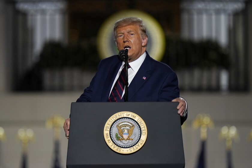President Trump leans on the podium during his acceptance speech at the Republican National Convention on Thursday night.