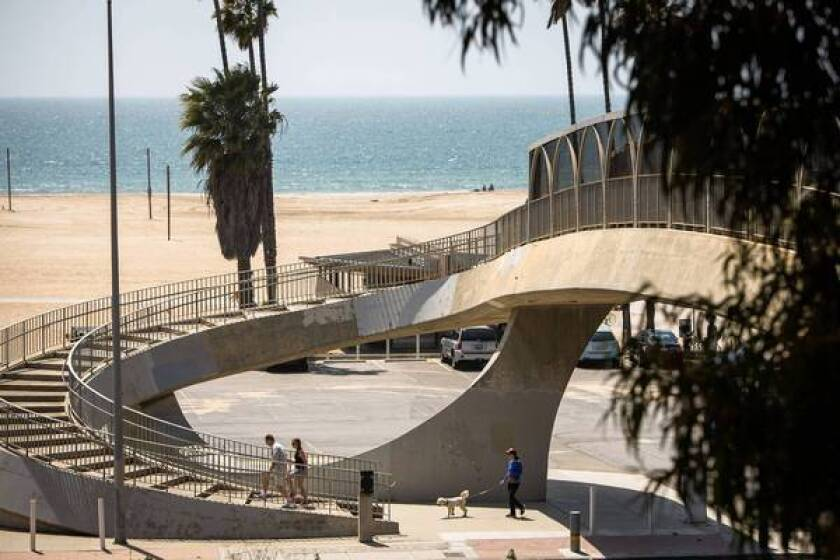 A wide spiral stairway crosses over Pacific Coast Hghway and onto the bluffs above the beach.