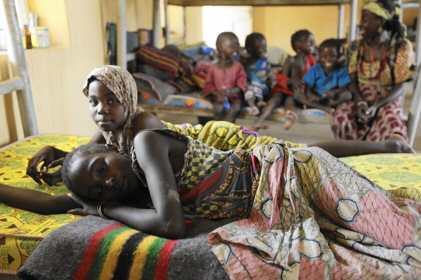Former captives of Boko Haram rest at a camp in Yola, Nigeria, after being rescued by Nigerian troops.