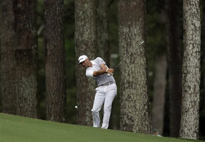Dustin Johnson hits off the second fairway during the second round of the Masters golf tournament Friday, April 12, 2013, in Augusta, Ga. (AP Photo/Charlie Riedel)