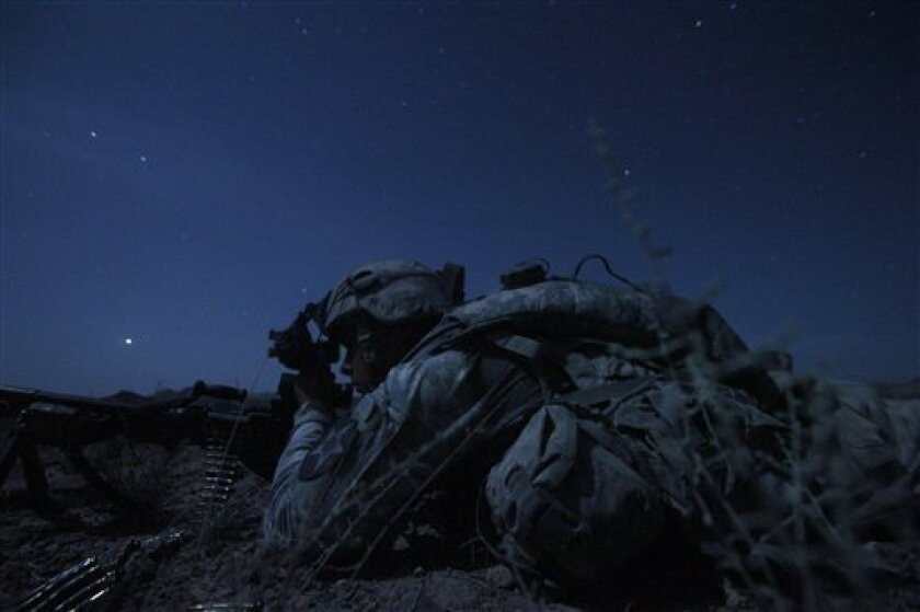 FILE - In this May 21, 2010 file photo, United States Army Spc. Kevin O'Connor, of Hingham, Mass. lays in wait under cover of darkness during an ambush set up by 2nd Platoon, Charlie Company, 1st Battalion, 17th Infantry Regiment of the 5th Stryker Brigade to catch Taliban fighters who had fired on their outpost in Afghanistan's Kandahar province. Twenty-two men in the U.S. Army's 1st Battalion, 17th Infantry Regiment of 800 died in a yearlong Afghan tour ending this summer. Most were killed last year in the Arghandab, a gateway to the southern city of Kandahar. About 70 were injured, all but two in bomb blasts. (AP Photo/Julie Jacobson, File)
