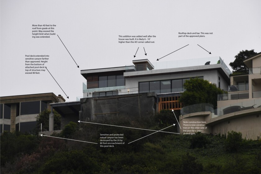 A photo shows what La Jolla architect Phil Merten calls potential construction violations at a house on Via Casa Alta.