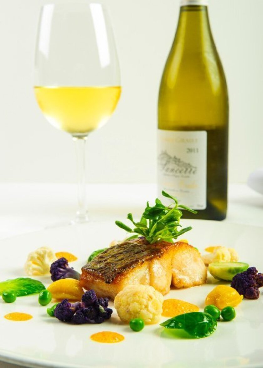 Fish with white wine from Tapenade Bistro. Courtesy Photo