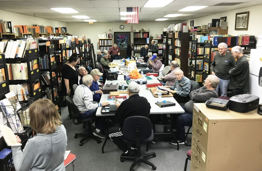 Poway Stamp Club members meeting in the San Diego County Philatelic Library prior to COVID-19.