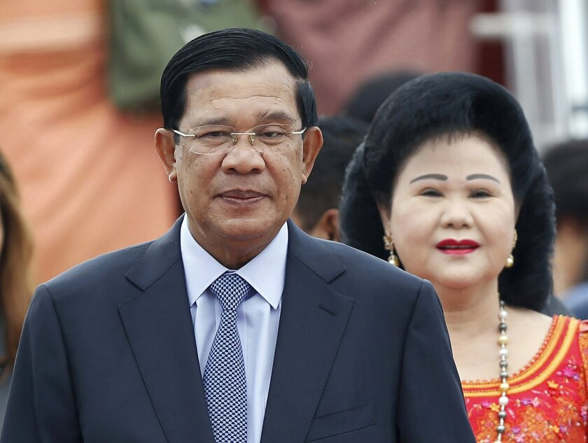 RETRANSMISSION WITH CORRECT SLUG - FILE - In this Nov. 20, 2015 file photo, Cambodia's Prime Minister Hun Sen and his wife Bun Rany arrive for the 27th Association of Southeast Asian Nations (ASEAN) summit, in Sepang, Malaysia. An extensive network of businesses controlled by the family of Cambodia