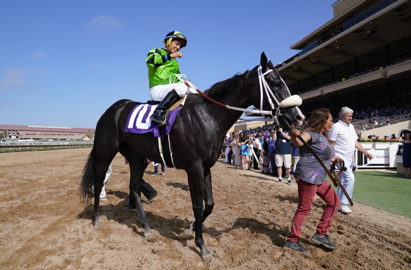 Jockey Victor Espinoza celebates his victory aboard Storming Lady in the fifth race on Del Mar's summer opening day.