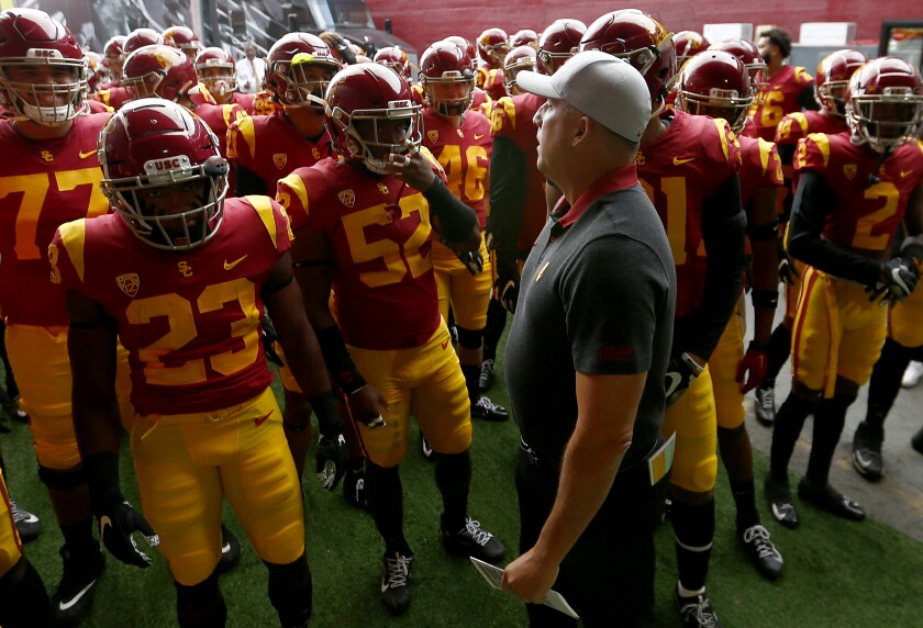 USC coach Clay Helton leads the Trojans unto the field before a game against Oregon on Nov. 2 at the Coliseum.