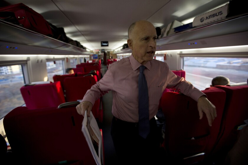 This year's state budget includes high-speed rail as an important part of California's landmark effort to reduce greenhouse gas emissions and fight climate change. Above: California Gov. Jerry Brown speaking to journalists from a high-speed train in China in 2013.
