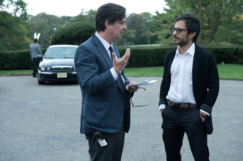 "Roman Coppola, left, an executive producer, speaks with Gael García Bernal on the set of ""Mozart in the Jungle."""