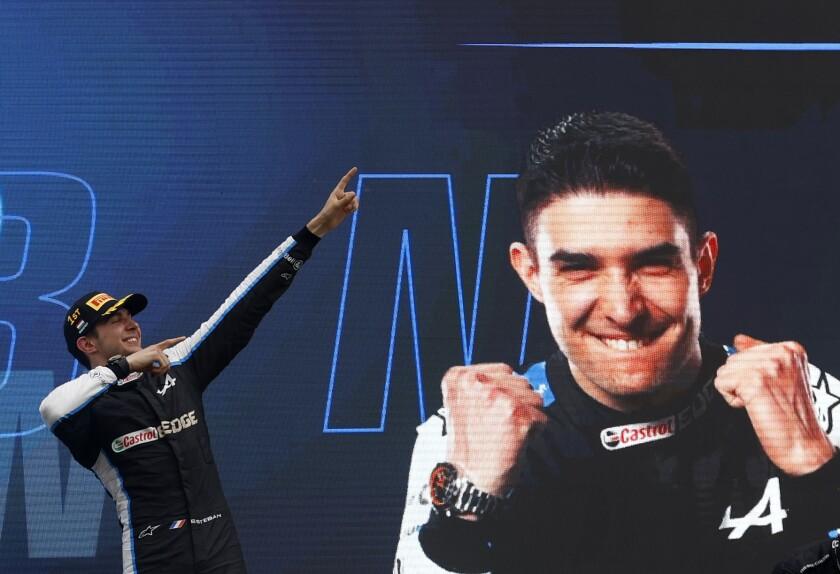 Race winner, Alpine driver Esteban Ocon of France celebrates on the podium after the Hungarian Formula One Grand Prix, at the Hungaroring racetrack in Mogyorod, Hungary, Sunday, Aug. 1, 2021. (Florion Goga/Pool via AP)