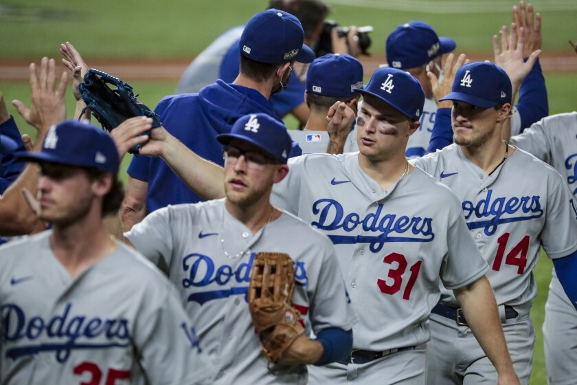 Dodgers players celebrate after their win over the Atlanta Braves in Game 3 of the National League Championship Series.