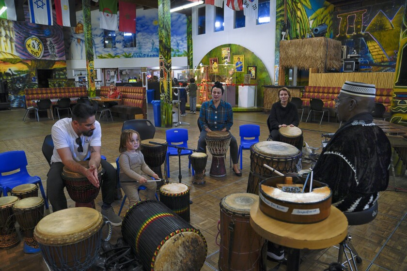 Nana Yaw Asiedu (right) teaches a drum workshop every Tuesday at the WorldBeat Cultural Center in Balboa Park. The drum workshop is one of the many events that occur weekly for the public.