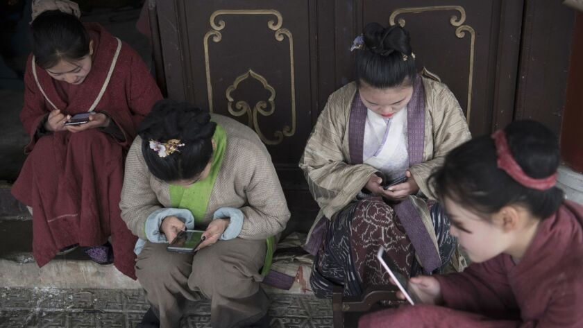 """Extras on set shooting """"The Story of Ming Lan"""" in Hengdian."""
