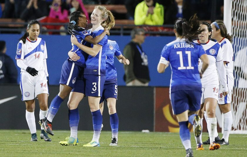 United States midfielder Samantha Mewis (3) is congratulated by forward Crystal Dunn, left, after scoring a goal during the second half of a women's Olympic qualifying soccer match against Puerto Rico, Monday, Feb. 15, 2016 in Frisco, Texas. United States won 10-0. (AP Photo/Brandon Wade)