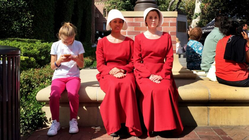 """Actresses in costume and character from the Hulu series """"The Handmaid's Tale,"""" based on the book by Margaret Atwood, in Los Angeles on April 23."""